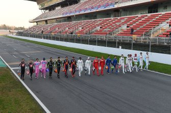 The drivers line up across the track