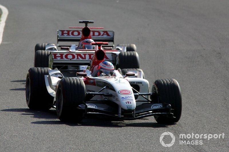 Jenson Button et Takuma Sato en piste