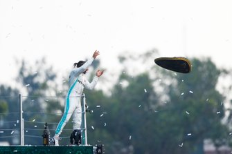 Race winner Lewis Hamilton, Mercedes AMG F1 throws the hat of Mario Achi, Mexican GP Promoter into the crowd from the podium