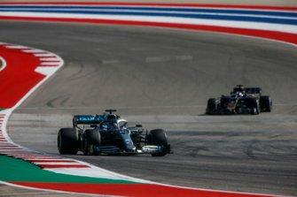 Lewis Hamilton, Mercedes AMG F1 W10, leads Romain Grosjean, Haas VF-19