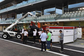 The car of Kimi Raikkonen, Sauber C37 is recovered to the pits