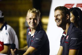 Romain Grosjean, Haas F1 Team, and Kevin Magnussen, Haas F1 Team, attend a fan event.
