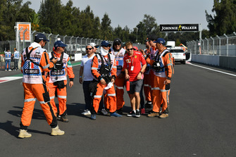 Sebastian Vettel, Ferrari takes photographs with marshals on track walk