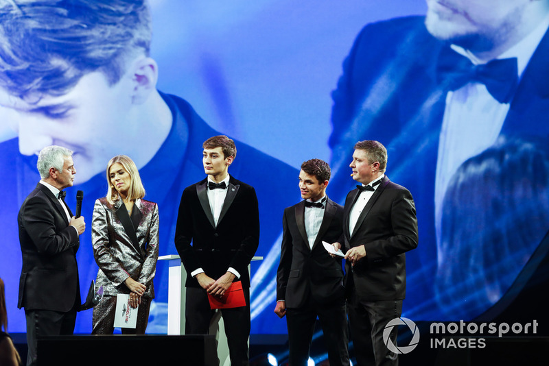 Williams F1 Driver George Russell, and McLaren F1 driver Lando Norris on stage to present the National Racing Driver Award to Dan Ticktum, accepted on his behalf by Derek Warwick
