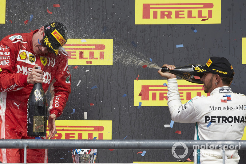 Lewis Hamilton, Mercedes AMG F1, 3rd position, sprays Kimi Raikkonen, Ferrari, 1st position, with Champagne on the podium