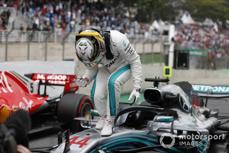 Lewis Hamilton, Mercedes AMG F1, celebrates taking pole position in parc ferme.
