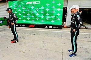 Lewis Hamilton, Mercedes, and pole man Valtteri Bottas, Mercedes, in Parc Ferme after Qualifying