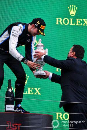 Esteban Ocon, Alpine F1, 1st position, receives his trophy on the podium