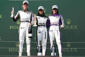 Alice Powell, Jamie Chadwick and Nerea Marti celebrate on the podium