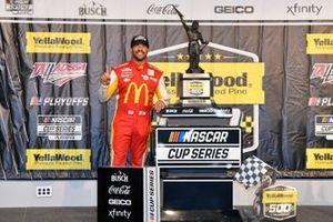 Bubba Wallace, 23XI Racing, Toyota Camry McDonald's, celebrates after winning.