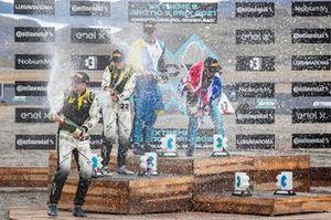 Mikaela Ahlin-Kottulinsky, Kevin Hansen, JBXE Extreme-E Team, 2nd position, and Catie Munnings, Timmy Hansen, Andretti United Extreme E, 1st position, on the podium