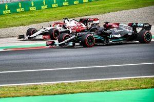 Lewis Hamilton, Mercedes W12, passes as Kimi Raikkonen, Alfa Romeo Racing C41, runs wide