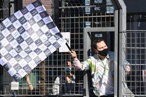 Tijs Michiel Verwest, known as Tiesto, waves the chequered flag