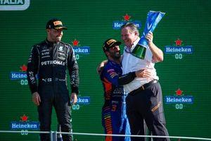 Valtteri Bottas, Mercedes, 3rd position, Daniel Ricciardo, McLaren, 1st position, and Zak Brown, CEO, McLaren Racing, celebrate on the podium