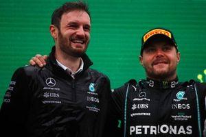 The Mercedes trophy delegate and Valtteri Bottas, Mercedes, 1st position, on the podium