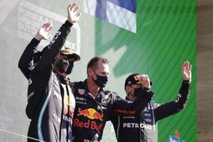 Lewis Hamilton, Mercedes, 2nd position, Max Verstappen, Red Bull Racing, 1st position, the Red Bull trophy delegate and Valtteri Bottas, Mercedes, 3rd position, on the podium