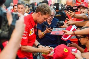 Sebastian Vettel, Ferrari signs autographs for fans
