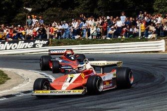 Carlos Reutemann, Ferrari 312T3; Niki Lauda, Brabham BT46