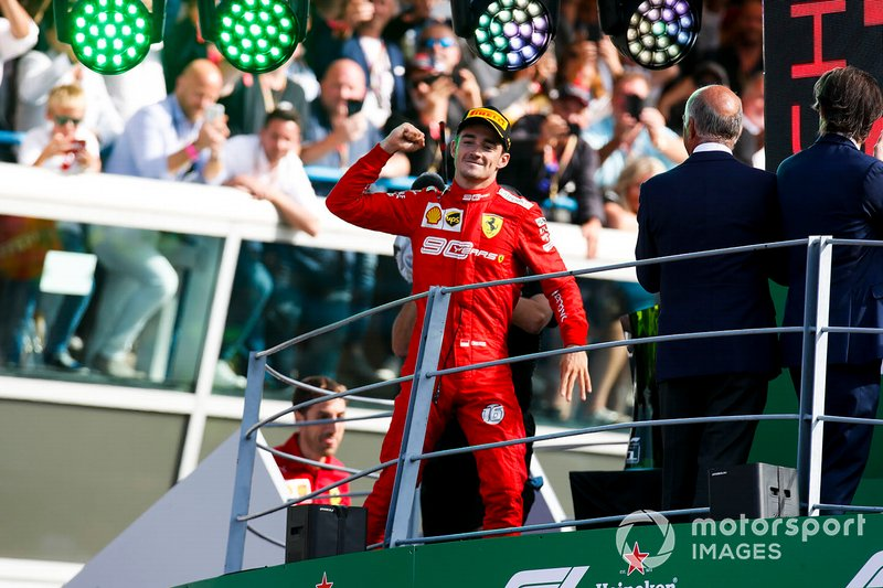 Charles Leclerc, Ferrari, 1st position, celebrates on the podium