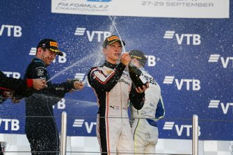 Nyck De Vries, ART Grand Prix, celebrates winning the drivers' title with Nicholas Latifi, Dams and Louis Deletraz, Carlin