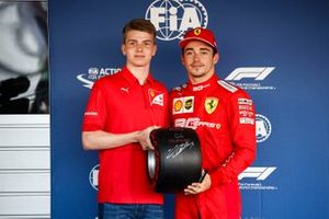 Charles Leclerc, Ferrari, celebrates pole position, and receives his Pirelli pole trophy from Robert Shwartzman, PREMA Racing