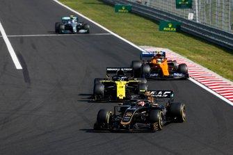Kevin Magnussen, Haas F1 Team VF-19, leads Daniel Ricciardo, Renault F1 Team R.S.19, Lando Norris, McLaren MCL34, and Valtteri Bottas, Mercedes AMG W10