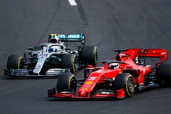 Sebastian Vettel, Ferrari SF90, passes Valtteri Bottas, Mercedes AMG W10, at the start