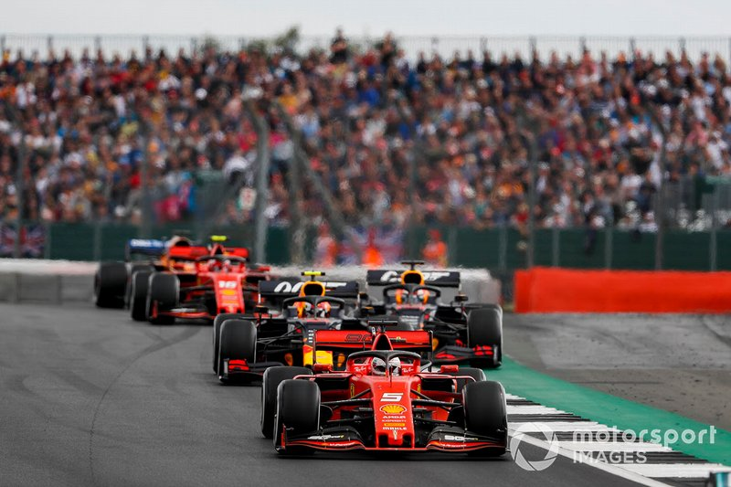 Sebastian Vettel, Ferrari SF90, leads Pierre Gasly, Red Bull Racing RB15, Max Verstappen, Red Bull Racing RB15, and Charles Leclerc, Ferrari SF90