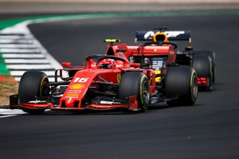 Charles Leclerc, Ferrari SF90, leads Max Verstappen, Red Bull Racing RB15