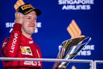 Sebastian Vettel, Ferrari, 1st position, with his trophy