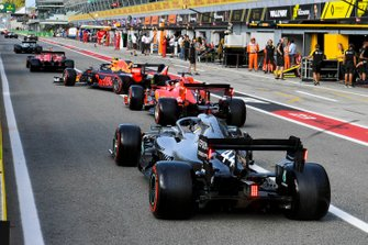 Valtteri Bottas, Mercedes AMG W10, Charles Leclerc, Ferrari SF90, Alex Albon, Red Bull RB15, Sebastian Vettel, Ferrari SF90, and Lewis Hamilton, Mercedes AMG F1 W10, head out of the pits