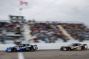 Andrew Ranger (27) leads L.P. Dumoulin to the start/finish line late in the Luxxur 300 Saturday
