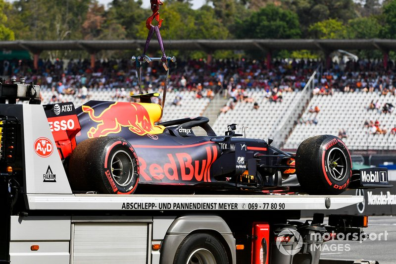 The damaged car of Pierre Gasly, Red Bull Racing RB15, on a truck
