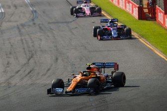 Lando Norris, McLaren MCL34, leads Alexander Albon, Toro Rosso STR14, and Sergio Perez, Racing Point RP19