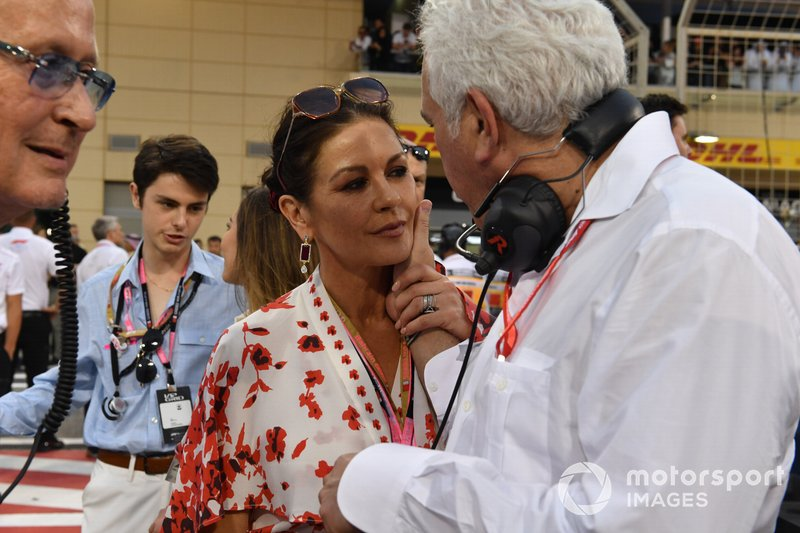 Mansour Ojjeh, co-owner, McLaren, Catherine Zeta Jones and Lawrence Stroll on the grid