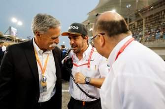 Chase Carey, Chairman, Formula 1, and Fernando Alonso on the grid
