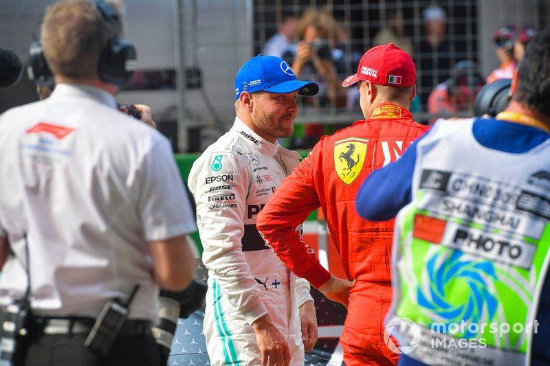 Pole man Valtteri Bottas, Mercedes AMG F1, on the grid with Sebastian Vettel, Ferrari,