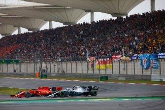 Charles Leclerc, Ferrari SF90, battles with Valtteri Bottas, Mercedes AMG W10
