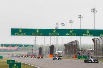 Lewis Hamilton, Mercedes AMG F1 W10, leads Valtteri Bottas, Mercedes AMG W10, Charles Leclerc, Ferrari SF90, and Sebastian Vettel, Ferrari SF90