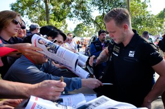Kevin Magnussen, Haas F1 Team signs autographs for fans