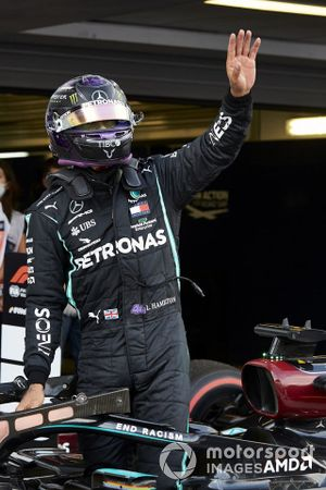 Pole man Lewis Hamilton, Mercedes-AMG F1, waves to fans in Parc Ferme