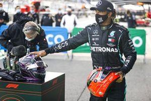 Lewis Hamilton, Mercedes-AMG F1, 1st position, with the helmet of Michael Schumacher in Parc Ferme