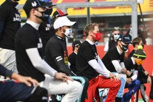 Lewis Hamilton, Mercedes-AMG F1, Sebastian Vettel, Ferrari, George Russell, Williams Racing, and the other drivers stand and kneel in support of the End Racism campaign prior to the start