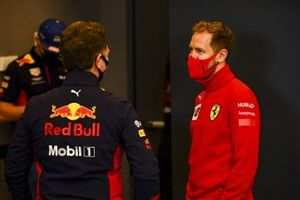 Christian Horner, Team Principal, Red Bull Racing and Sebastian Vettel, Ferrari talk in the press conference