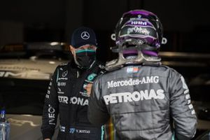 Valtteri Bottas, Mercedes-AMG F1, and Lewis Hamilton, Mercedes-AMG F1, congratulate each other after securing the front row in Qualifying