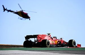Charles Leclerc, Ferrari SF1000, passes the Airbus H125 camera helicopter