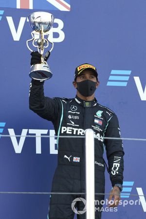 Lewis Hamilton, Mercedes-AMG F1, 3rd position, lifts his trophy on the podium