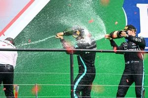 Peter Bonnington, Race Engineer, Mercedes AMG, Valtteri Bottas, Mercedes-AMG F1, 2nd position, and Lewis Hamilton, Mercedes-AMG F1, 1st position, spray Champagne on the podium
