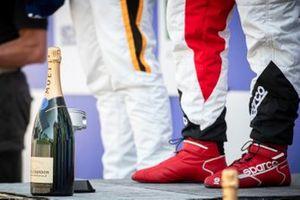 Bottiglia di Champagne sul podio