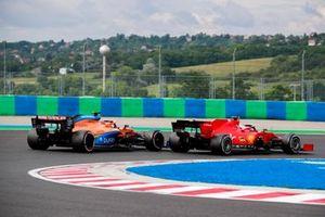 Carlos Sainz Jr., McLaren MCL35 and Charles Leclerc, Ferrari SF1000